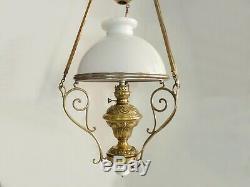 Grand lustre, suspension du XIXème à réservoir, structure laiton et métal doré