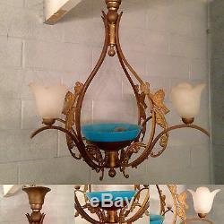 Lustre art déco en laiton, décor oiseaux, quatre bras de lumières. XX siècle
